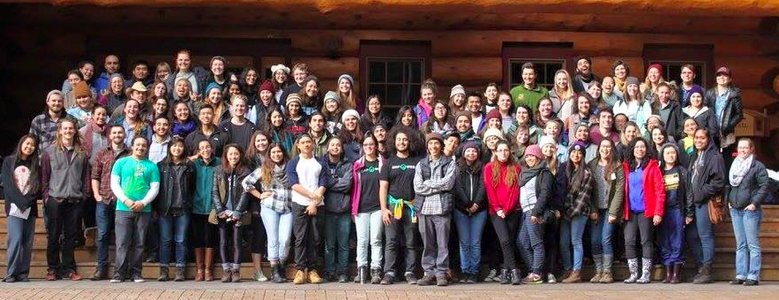 group photo of InterOrg participants in front of Swenson Lodge